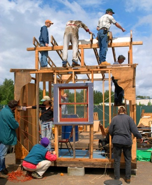 Volunteers help build a house